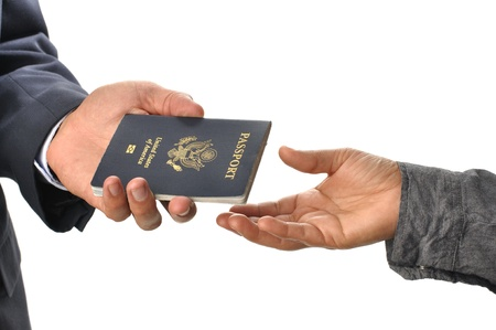closeup of man handing passport to woman, on white Stock Photo