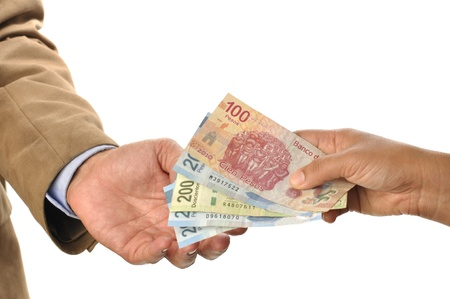 collecting: closeup of woman handing mexican pesos to man, on white background