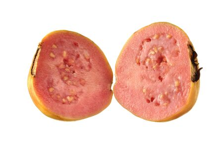 flesh: Fresh pink guava cut in half isolated on white