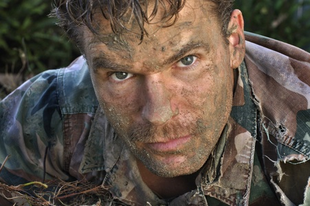 Head shot of military man with muddy face photo