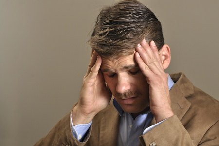 Closeup of man suffering from intense headache Stock Photo - 11767045