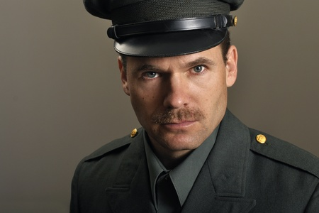 Head shot of army officer with mustache in uniform Stock Photo - 11767040