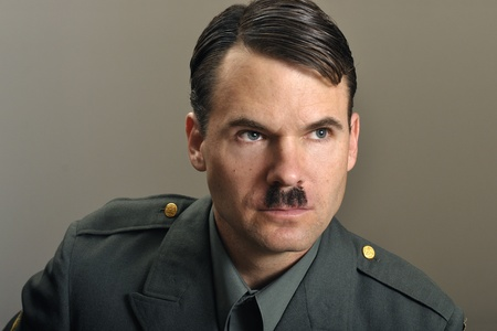 Head shot of stern military officer with narrow black mustache Stock Photo - 11767046