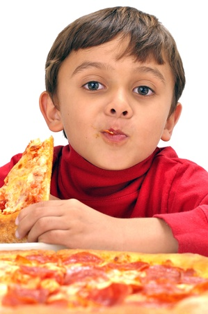 Cute little boy loves eating a slice of pizza photo