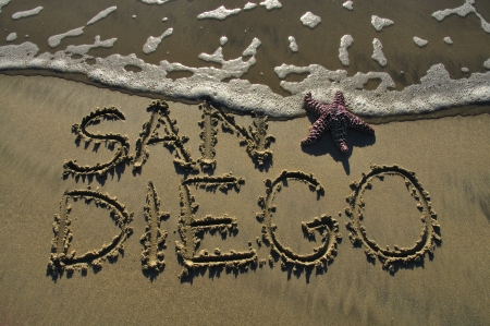 etch: San Diego written in sand at beach with sea star