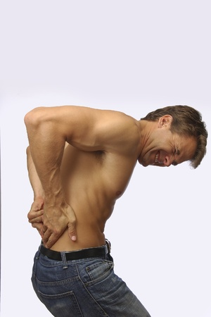 terrible: Toples muscular man suffers from terrible lower back pain