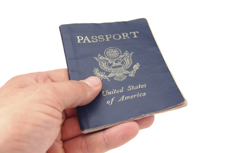 a patrol: Hand holding US passport on white background Stock Photo