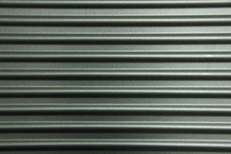 Gray horizontally corrugated metal wall photo