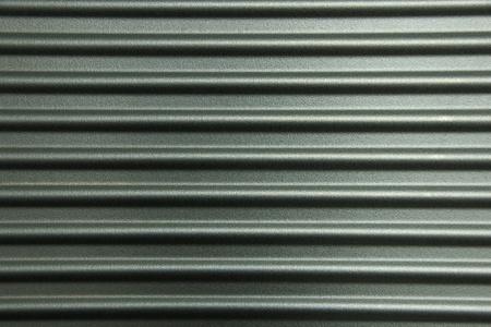 Gray horizontally corrugated metal wall Reklamní fotografie
