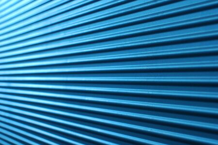 fade away: Blue horizontally corrugated metal wall with fade