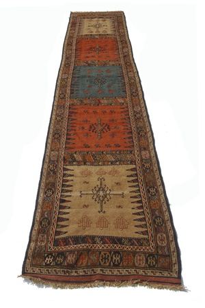 rug: Antique Middle Eastern runner rug on white background