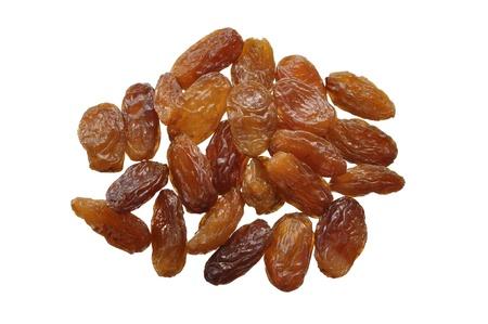 Closeup of golden raisins isolated on white Banco de Imagens