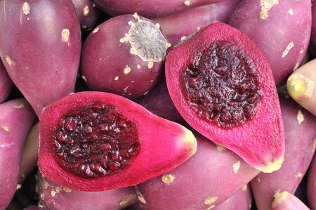 Closeup of cut halves of cactus pears in pile Stock Photo