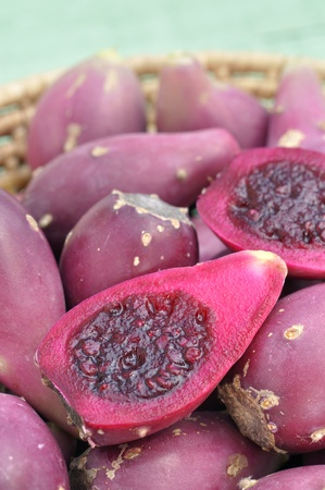 Closeup of sliced halves of cactus pears in basket Stock Photo