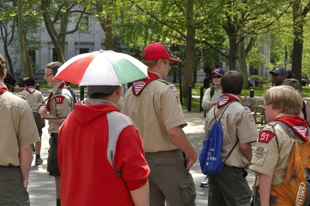 scouts: PHILADELPHIA, PA - INDEPENDENCE HALL - APRIL 21, 2012 - Boy with umbrella hat accompanies boy scouts at Independence Hall in Philadelphia, PA