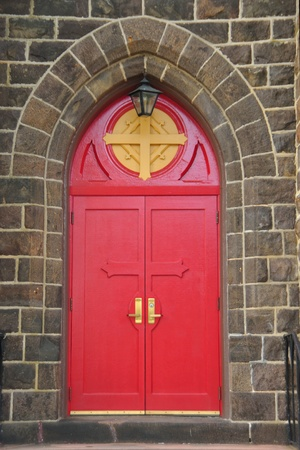 Gothic style red entrance doors of the Episcopal church in Vineland, New Jersey photo