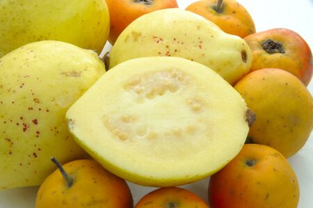 myrtaceae: Several guava and tejocote fruit on white