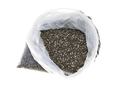 Plastic bag full of chia seeds isolated on white Stock Photo