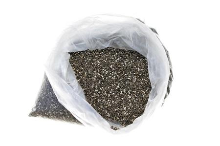 hispanica: Plastic bag full of chia seeds isolated on white Stock Photo