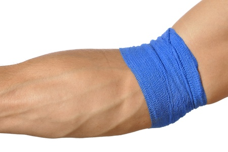 forearm: Closeup of arm wrapped at elbow with blue bandage on white background