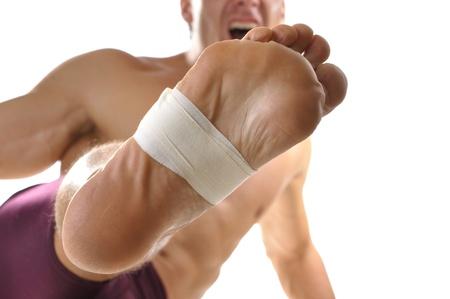Closeup of bottome of man s foot doing martial arts kick Stock Photo - 14308291