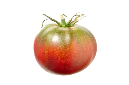 heirloom: Ripe black krim tomato isolated on white background