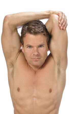 Muscular athletic shirtless man performing triceps stretch on white background photo