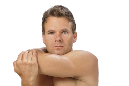 Muscular athletic shirtless man performing rear deltoid stretch photo