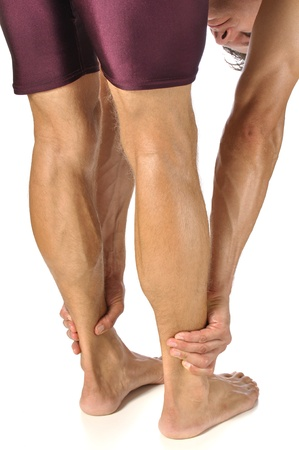 calves: Lean athletic man performing standing hamstrings stretch Stock Photo