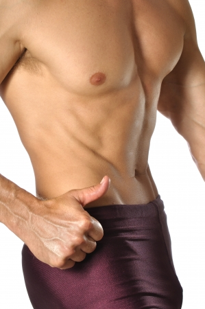 Closeup of lean muscular waist and torso of athletic man on white background Stock Photo - 14615201