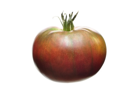 heirloom: Whole black krim heirloom tomato isolated on white