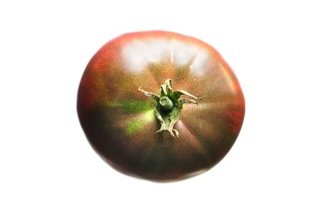 indeterminate: Top view of black krim heirloom tomato isolated on white