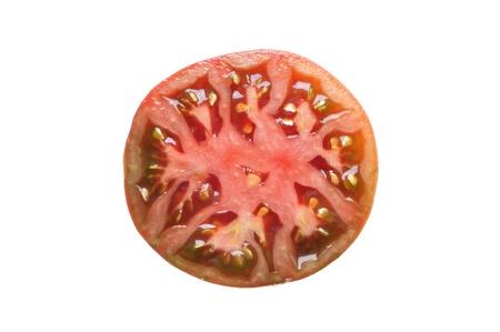 indeterminate: Half sliced black krim heirloom tomato isolated on white