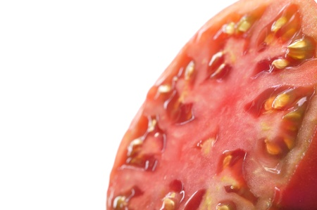 indeterminate: Closeup select focus of half sliced tomato on white background with text space