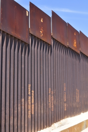 Detail of Mexican side of high border fence at Tijuana beach separating Mexico and the United States