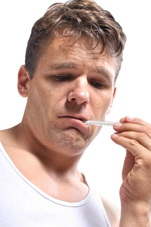 Closeup of very sick man with thermometer in mouth on white background photo