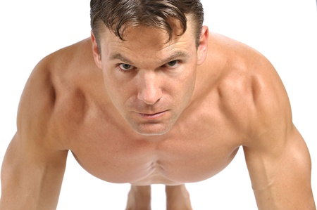 Closeup of topless muscular man in pushup exercise position with white background Stock Photo - 15769586