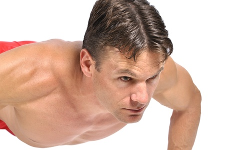Closeup of topless muscular man performing pushup on white background Stock Photo - 15769594