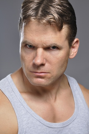mid adult man: Closeup of athletic Caucasian man with intense look of determination