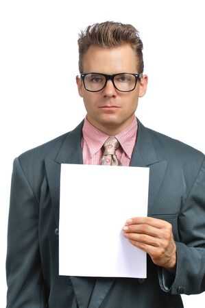 hire: Caucasian businessman with glasses in fashionable suit holds blank paper with copy space on white background