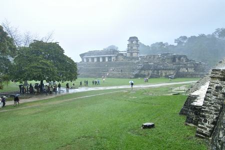 dampen: Palenque, Chiapas, Mexico - December 21, 2012: Heavy rains fail to dampen the spirits of travelers visiting the ancient Maya ruins on the final day of the Maya calendar on December 21, 2012