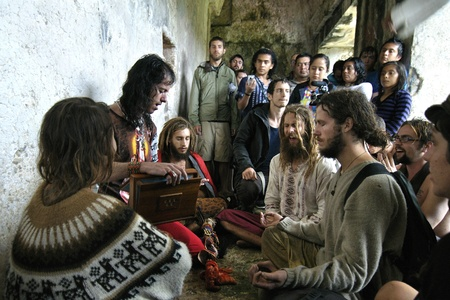 Palenque, Chiapas, Mexico - December 21, 2012:  Individuals participating in a Rainbow gathering unite in a hymn at exactly 1:11 pm CST in the Palace ruins of Palenque on December 21, 2012