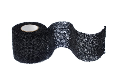 gauze: Closeup of single roll of black sport wrap isolated on white background