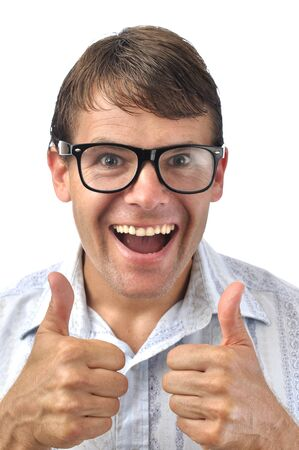 dweeb: Closeup of happy male nerd giving thumbs up sign with two hands on white background Stock Photo