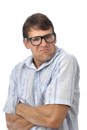 dweeb: Male nerd with glasses makes pouty face on white background