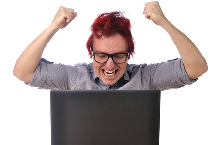 white fly: Young man angry with computer raises both fists and yells Stock Photo