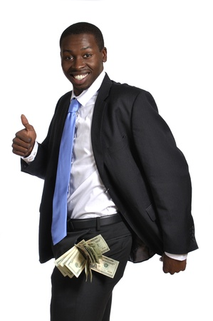 Young businessman with pockets fat of cash celebrates his success photo