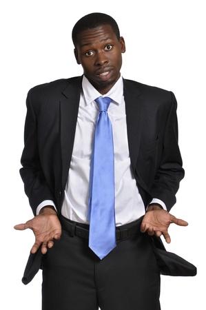 Jonge zakenman toont lege zakken en lege handen op witte achtergrond Stockfoto