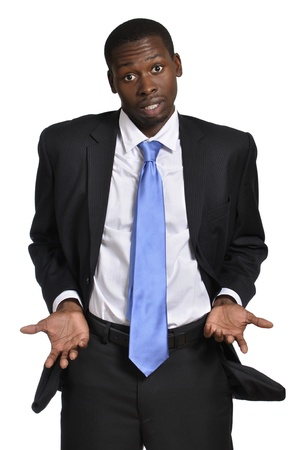 broke: Young business man shows empty pockets and empty hands on white background