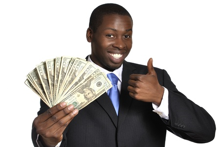Young successful businessman flaunts handful of money on white background